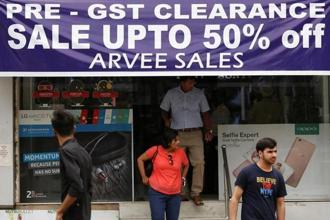 Industries are on strike, others are facing an avalanche of paperwork, while some retailers remain unclear about what to charge just days before the taxes take effect. Photo: Reuters