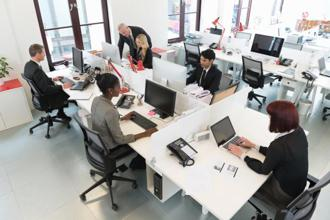 For an employer, the long-term allure of the artificially intelligent desk isn't just a healthier workforce but access to data on how workers use their space. Photo: iStock