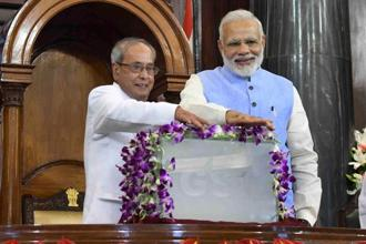 President Pranab Mukherjee (Left) and Prime Minister Narendra Modi during the GST launch in the Parliament at Friday midnight. Photo: PTI