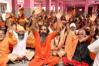 Sadhus wait to get registered for Amarnath yatra at a base camp in Jammu. PTI