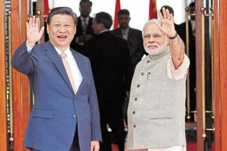 A file photo of Prime Minister Narendra Modi and Chinese president Xi Jinping. Both leaders met in early June on the sidelines of the Shanghai Cooperation Organisation (SCO). Photo: Reuters