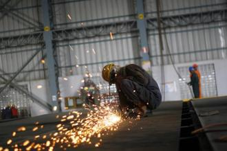 Factory activity has recovered since December, when it contracted for the first time in a year after Narendra Modi's 8 November move to ban high-value currency notes crunched demand. Photo: Bloomberg