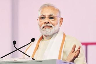 PM Narendra Modi's book will cover many aspects that students can relate to, especially with regard to the crucial Class X and Class XII examinations. Photo: AFP