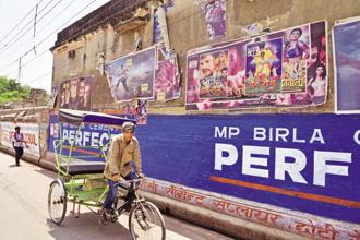 Movie posters in Varanasi. The reluctance among audiences to settle for anything but the best movie experience has fuelled the multiplex revolution and sounded the death knell for single-screen theatres. Photo: Ramesh Pathania/Mint