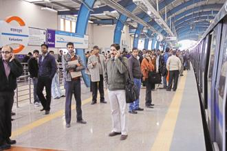 A Metro station invokes a ritual of stepping out of the ordinary world into a 'sacred' space. Photo: Hindustan Times
