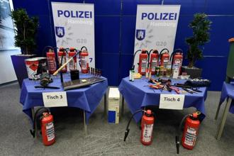 Dangerous items, which were confiscated by the police, are shown during a press conference at the Police headquarters before the upcoming G20 summit in Hamburg, Germany, 4 July. Photo: Fabian Bimmer/Reuters