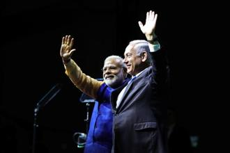 Indian Prime Minister Narendra Modi and his Israeli counterpart Benjamin Netanyahu wave to the crowd during a reception for the Indian community in Israel, in Tel Aviv, on Wednesday. Reuters.