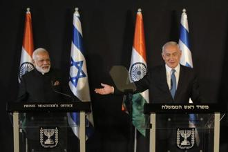 Indian Prime Minister Narendra Modi, left, listens as Israeli Prime Minister Benjamin Netanyahu speaks during their meeting at the King David hotel in Jerusalem on Wednesday. Israel and India have signed a series of agreements to cooperate in the fields of technology, water and agriculture. Photo: AP
