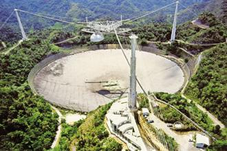 The Arecibo radio telescope in Puerto Rico that Drake used to send the 1,679 message into space. Picture: Wikimedia Commons