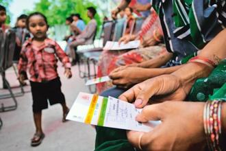 The apex court, however, had allowed the Centre to seek Aadhaar card voluntarily from citizens for extending benefits of schemes like LPG subsidy, Jan Dhan scheme and Public Distribution System. Photo: Mint