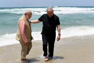 Narendra Modi and Benjamin Netanyahu repeatedly affirmed their shared goals and friendship and even waded barefoot in the Mediterranean surf. Photo: AFP/PIB
