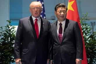 US President Donald Trump and Chinese President Xi Jinping (right) meet on the sidelines of the G20 Summit in Hamburg, Germany, 8 July. Photo: Reuters