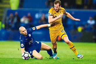 Yohan Benalouane (left) of Leicester City tackling Harry Kane of Tottenham Hotspur during a Premier League match in May. Photo: Tony Marshall/Getty Images.
