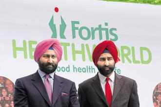 Malvinder Singh (left) and Shivinder Mohan Singh directly and through holding companies RHC Holding and RHC Finance, own 50.88% in Religare Enterprises. Photo: HT