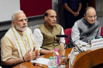 Prime Minister Narendra Modi, home minister Rajnath Singh and finance minister Arun Jaitley at an all-party meeting ahead of monsoon session of Parliament, in New Delhi on Sunday. Photo: PTI