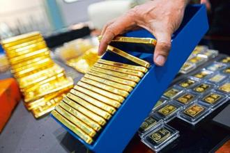 Spot gold was up 0.3% to $1,237.66 per ounce at around 12pm on Tuesday. Photo: Bloomberg