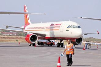 Air India's net tax after loss narrowed by around 5% to Rs3,643 crore in 2016-17. Photo: Bloomberg