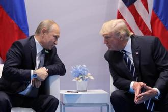 Russia's president Vladimir Putin talks to US President Donald Trump during their bilateral meeting at the G20 summit in Hamburg, Germany on 7 July 2017. Photo: Reuters