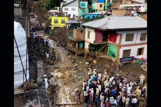 A flash flood washed away houses following a cloudburst at Thathri village in Doda district of Jammu and Kashmir on Thursday. Photo: PTI