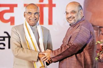 President-elect Ram Nath Kovind being congratulated by BJP president Amit Shah after his victory in New Delhi on Thursday. Photo: Reuters