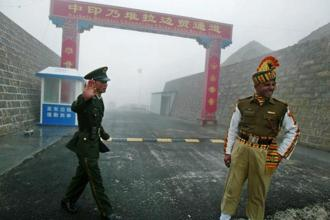 A file photo of a Chinese soldier and an Indian soldier at the Nathu La border crossing between India and China. China is everywhere these days, challenging the global order at times, and at others trying to be the guarantor of the global economic order in the age of Donald Trump. Photo: AFP