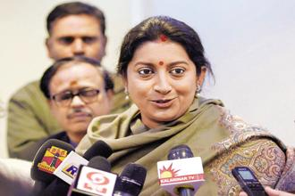 Smriti Irani urged the business community to become a part of historic tax reform by adopting the goods and services tax (GST). Photo: PTI
