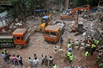 Excavators remove debris following a building collapse at Ghatkopar in Mumbai on Wednesday. Reuters
