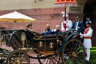 President Ram Nath Kovind with outgoing president Pranab Mukherjee in the traditional buggy after inspecting the guard of honour in New Delhi on Tuesday. Photo: PTI/PIB