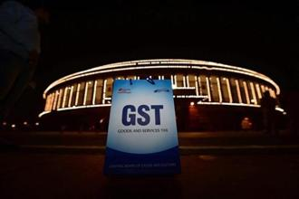 The GST was originally expected to boost India's economic growth by as much as 2 percentage points. However, a convoluted structure has made many economists mark down their expectations. Photo: PTI