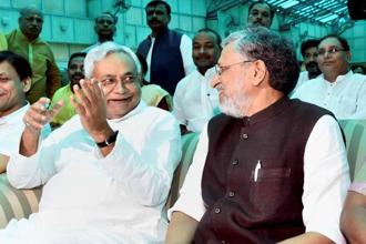 Nitish Kumar (left) took oath as chief minister of Bihar on Thursday, Sushil Kumar Modi was sworn in as deputy chief minister. Photo: PTI
