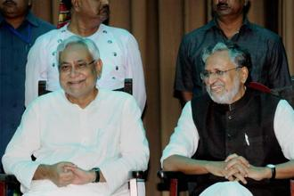 Bihar chief minister Nitish Kumar with deputy CM Sushil Kumar Modi at their oath taking ceremony in Patna on Thursday. Photo: PTI