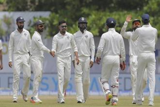 Indian team celebrates the dismissal of Sri Lanka's Angelo Mathews during the fourth day's play of the first Test match in Galle on Saturday. Photo: PTI