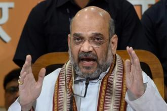 BJP national president Amit Shah addressing a press conference at the UP BJP office in Lucknow on Monday.  Photo: PTI