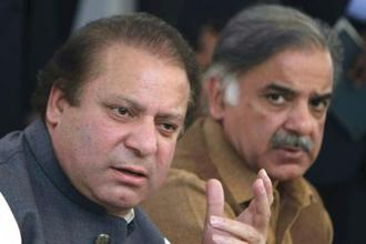 File photo: Pakistan's deposed prime minister Nawaz Sharif addresses a news conference along with his brother Shehbaz Sharif in Lahore on Saturday. Photo: AP