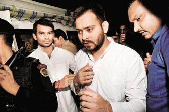 Tejashwi Yadav, RJD boss Lalu Prasad's older son, is saddled with corruption charges that date back to a time when he was only 14 years old. Photo: PTI