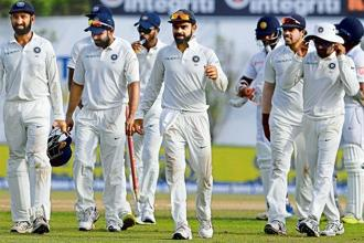 The Indian team after winning the first Test against Sri Lanka on 29 July. Photo: AP