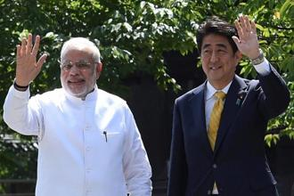 Prime Minister Narendra Modi (left), as Japan investors are noticing, has put far more reform wins on the scoreboard than their own leader, Shinzo Abe. Photo: PTI