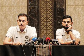 Captain Virat Kohli and head coach Ravi Shastri at a news conference in Mumbai. Photo: Dinuka Liyanawatte/Reuters