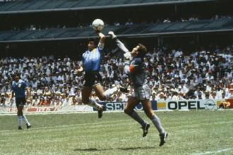 Diego Maradona scoring his 'Hand of God' goal past England goalkeeper Peter Shilton on 22 June, 1986. Photo: Getty Images