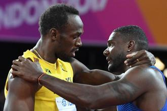 Justin Gatlin (R) embraces Usain Bolt after winning the men's 100m sprint event at the 2017 IAAF World Championships at the London Stadium in London on Saturday. Photo: AFP