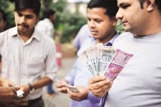 The rupee opened at 63.92 a dollar and touched a high and a low of 63.89 and 64.09, respectively. Photo: Mint