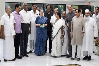 Congress president Sonia Gandhi, West Bengal CM and TMC supremo Mamata Banerjee, BSP's Satish Chandra Mishra, Samajwadi Party's Naresh Agarwal, CPI's D Raja and other leaders of opposition parties after a meeting in New Delhi on Friday. Photo: PTI