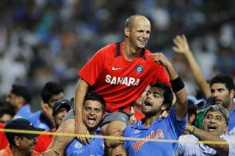 Suresh Raina and Virat Kohli carry coach Gary Kirsten, a South African, during celebrations after India won the ICC Cricket World Cup in Mumbai on 2 April 2011. Photo: Reuters