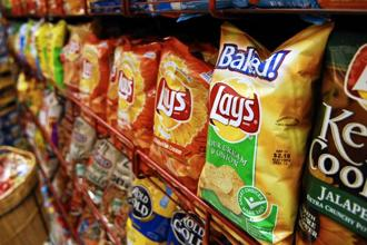 Namkeen, bhujias and potato chips should attract 5% tax and not 12%, as per a demand put before the GST council. Photo: Bloomberg