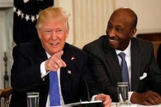 Merck & Co. CEO Ken Frazier (right) listens to US President Donald Trump speak during a meeting with manufacturing CEOs at the White House in Washington, DC, US on 23 February 2017. Photo: Reuters