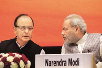 Prime Minister Narendra Modi, right, with finance minister Arun Jaitley. India lost the tag of the fastest growing major economy to China in the March quarter with a GDP growth of 6.1%, which pulled down the 2016-17 expansion to 7.1%. Photo: Bloomberg