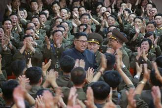 North Korean leader Kim Jong-un inspected the command of the North's army on Monday, examining a plan to fire missiles towards Guam. Reuters