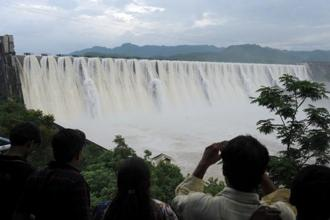 File photo of the Narmada dam. In the early 2000s, government attempted, incredibly, to specify the number of houses that would be submerged. Photo: AFP