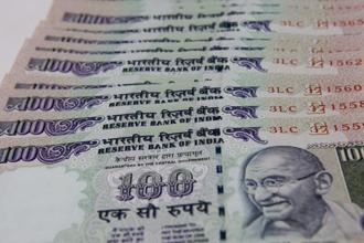 The rupee opened at 64.28 a dollar and touched a high and a low of 64.14 and 64.33, respectively. Photo: Hindustan Times