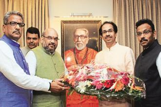 Shiv Sena chief Uddav Thackeray (second from left) and BJP president Amit Shah (3rd from left).